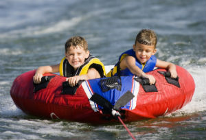 boys tubing on lake ozark